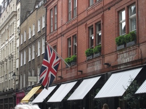 Picture of building in London with the British flag