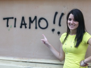 Student in front of Italian graffiti