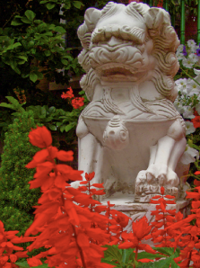 Dragon statue and red flowers