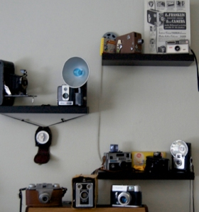 Camera Collection on Shelf in the Wakerly Technology Training Center at Marquette University.