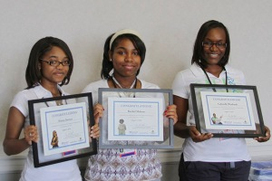 Messmer students with certificates of internship completion.